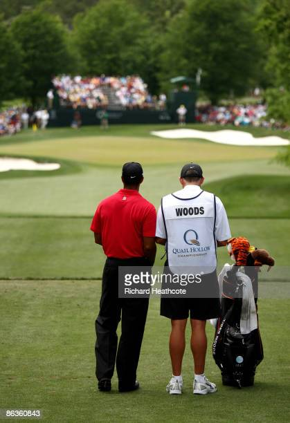 Tiger Woods of the USA and caddy Steve Williams look towards the green from the 6th tee during the final round of the Quail Hollow Championship at...