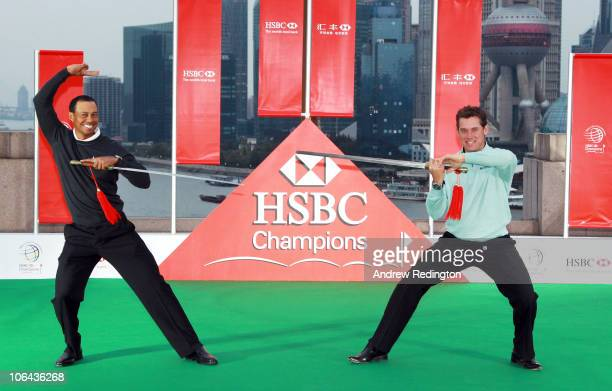 Tiger Woods of the USA and Lee Westwood of England cross swords during the 2010 WGC-HSBC Champions Photocall at The Peninsula hotel on The Bund,...