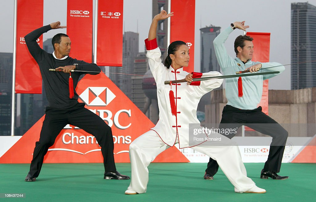 Tiger Woods of the USA (L) and Lee Westwood of England receive a Tai Chi lesson with swords during the 2010 WGC-HSBC Champions Photocall at The Peninsula hotel on The Bund, Shanghai on November 2, 2010 in Shanghai, China.