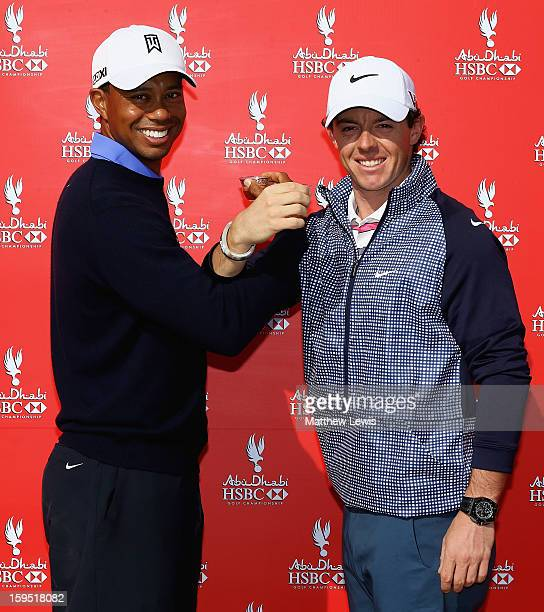 Tiger Woods of the USA and Rory McIlroy of Northern Ireland drink coffee during a photocall ahead of the Abu Dhabi HSBC Golf Championship at Abu...