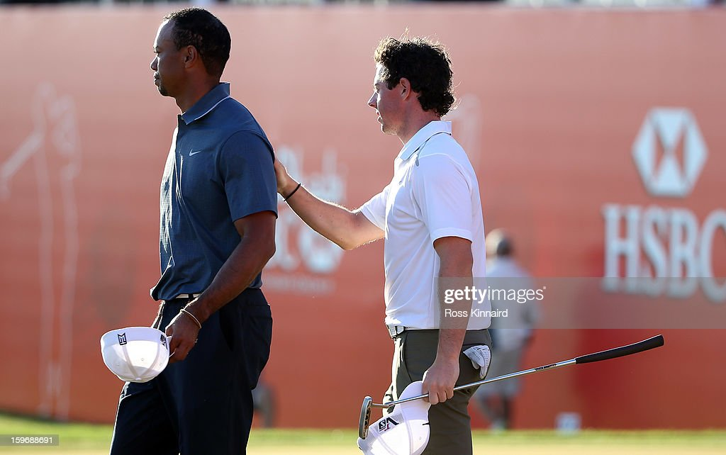 Tiger Woods of the USA and Rory McIlroy of Northern Ireland on the 18th green during the second round of the Abu Dhabi HSBC Golf Championship at the Abu Dhabi Golf Club on January 18, 2013 in Abu Dhabi, United Arab Emirates.