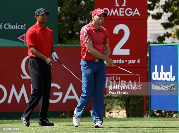 Tiger Woods of the USA and Sergio Garcia of Spain during the final round of the Omega Dubai Desert Classic on the Majlis course at the Emirates Golf...