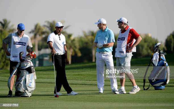 Tiger Woods of the USA and Stephen Gallacher of Scotland during the Champions Challenge prior to the Omega Dubai Desert Classic on the Majlis Course...