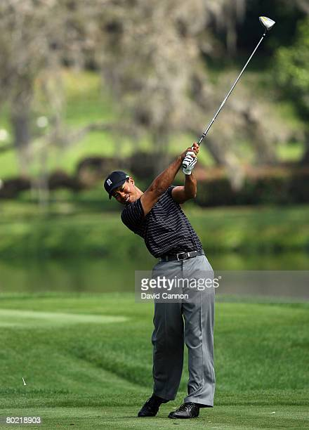 Tiger Woods of the USA at full extension after impact as he hits his tee shot to the 16th hole during the pro-am for the 2008 Arnold Palmer...