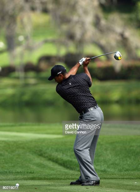 Tiger Woods of the USA at the top of his swing as he hits his tee shot to the 16th hole during the pro-am for the 2008 Arnold Palmer Invitational...