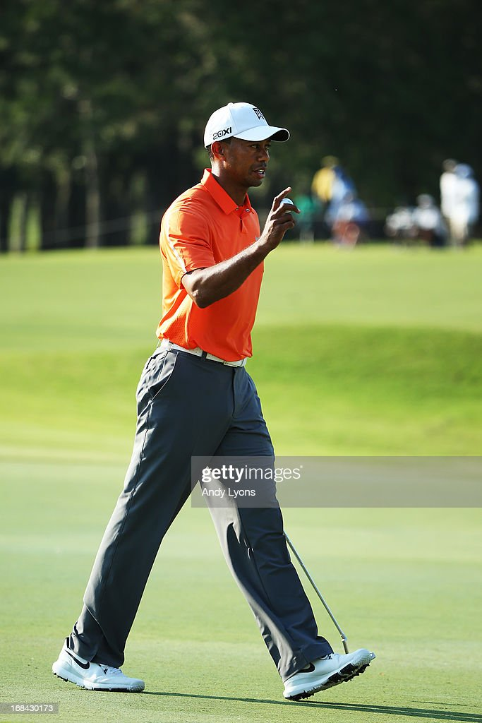 Tiger Woods of the USA celebrates a birdie putt on the 16th hole during round one of THE PLAYERS Championship at THE PLAYERS Stadium course at TPC Sawgrass on May 9, 2013 in Ponte Vedra Beach, Florida.