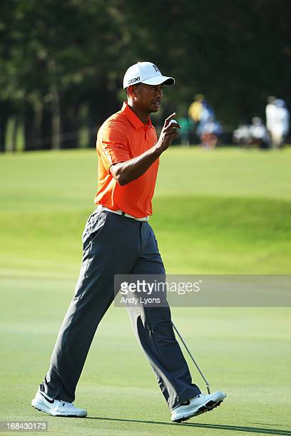 Tiger Woods of the USA celebrates a birdie putt on the 16th hole during round one of THE PLAYERS Championship at THE PLAYERS Stadium course at TPC...