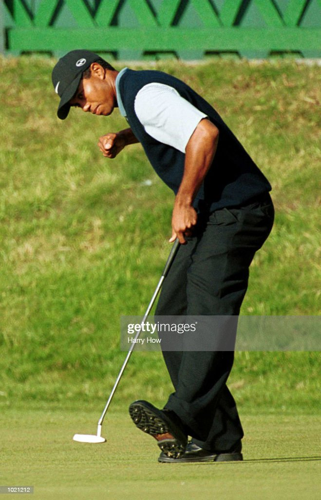 Tiger Woods of the USA celebrates after holing a birdie putt on the 18th green during the third round of the British Open Golf Championships on July 22,2000 at the Old Course, St Andrews, Scotland.
