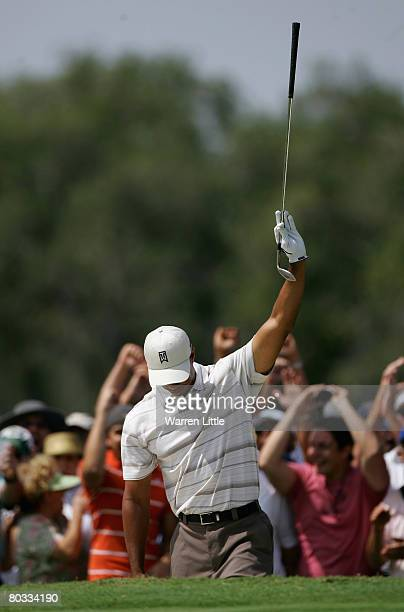 Tiger Woods of the USA celebrates an eagle out of the 12th greenside bunker during the second round of the 2008 World Golf Championships CA...