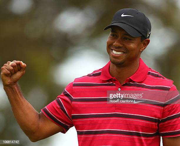 Tiger Woods of the USA celebrates sinking a putt during day four of the Australian Masters at The Victoria Golf Club on November 14 2010 in Melbourne...