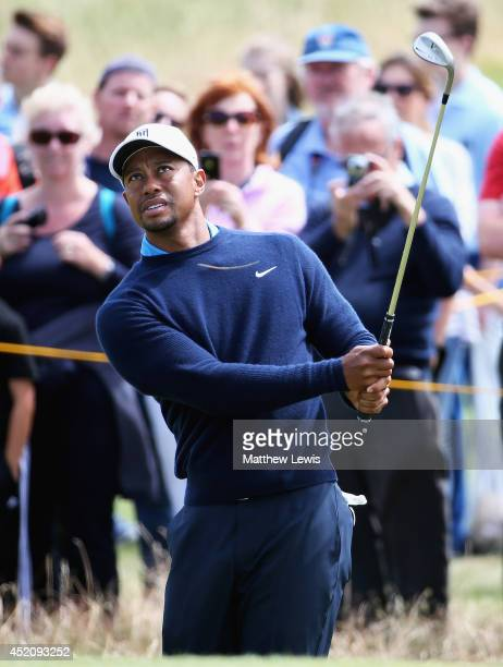 Tiger Woods of the USA chips onto the 6th green during a practice round ahead of the 143rd Open Championship at Royal Liverpool on July 13 2014 in...