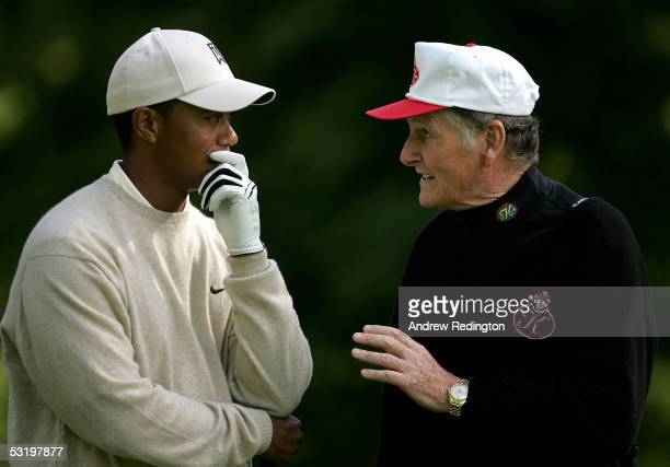 Tiger Woods of the USA converses with Dr Michael Smurfit during the second round of the JP McManus Invitational ProAm event on July 5 2005 at the...