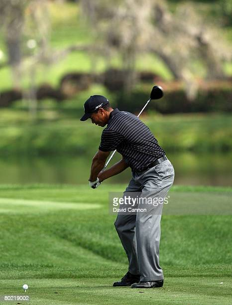 Tiger Woods of the USA halfway through his downswing as he hits his tee shot to the 16th hole during the pro-am for the 2008 Arnold Palmer...
