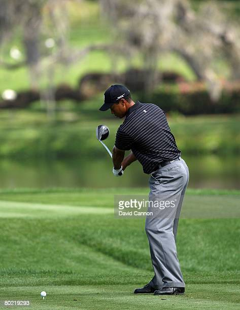 Tiger Woods of the USA halfway through his takeaway as he hits his tee shot to the 16th hole during the pro-am for the 2008 Arnold Palmer...