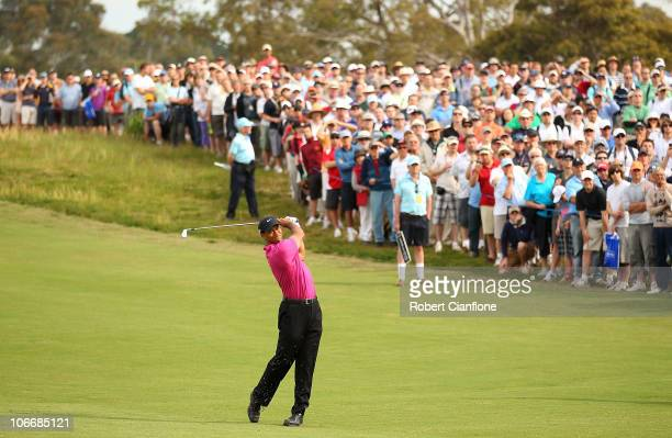 Tiger Woods of the USA hits a shot off the fairway during day one of the Australian Masters at The Victoria Golf Club on November 11, 2010 in...