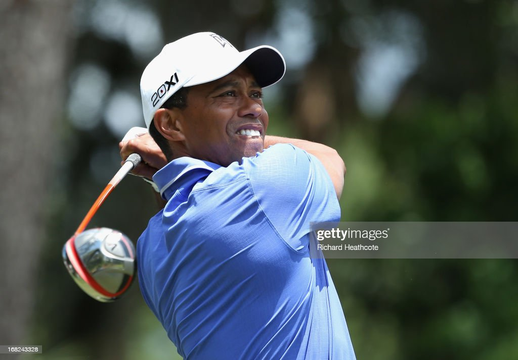 Tiger Woods of the USA hits a tee shot during a practise round for THE PLAYERS Championship at TPC Sawgrass on May 7, 2013 in Ponte Vedra Beach, Florida.