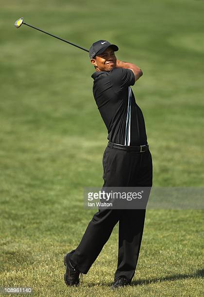 Tiger Woods of the USA hits from the fairway during the first round of the 2011 Omega Dubai Desert Classic held on the Majilis Course at the Emirates...