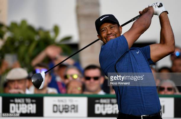 Tiger Woods of the USA hits his opening tee shot on the par five 10th hole during the first round of the Omega Dubai Desert Classic at Emirates Golf...
