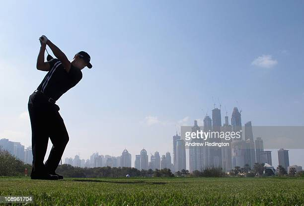 Tiger Woods of the USA hits his teeshot on the eighth hole during the first round of the Omega Dubai Desert Classic on the Majlis course at the...