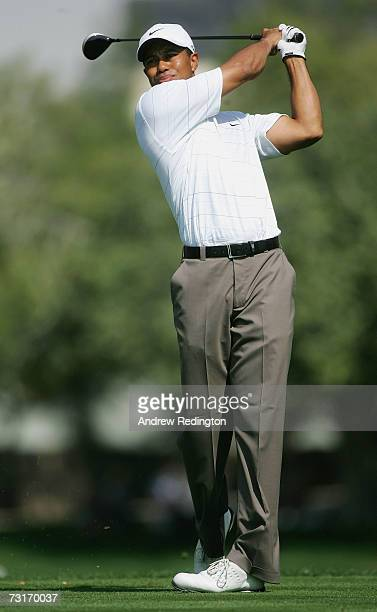 Tiger Woods of the USA hits his teeshot on the fifth hole during the first round of the Dubai Desert Classic on the Majilis Course at Emirates Golf...