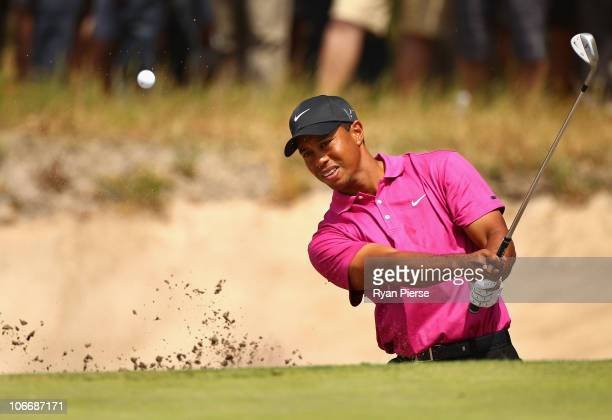 Tiger Woods of the USA hits out of a bunker during day one of the Australian Masters at The Victoria Golf Club on November 11, 2010 in Melbourne,...