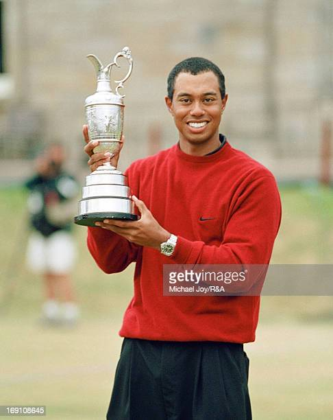 Tiger Woods of the USA holding the Claret Jug after his victory in the 2000 Open Championship held on the Old Course at St Andrews on July 23, 1964...