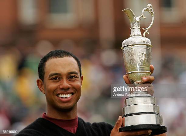 Tiger Woods of the USA holds the Claret Jug aloft after securing a five shot victory at the 134th Open Championship at Old Course St Andrews Golf...