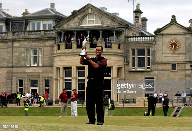 Tiger Woods of the USA holds the Claret Jug aloft in front of the RA Clubhouse after securing a five shot victory at the 134th Open Championship at...