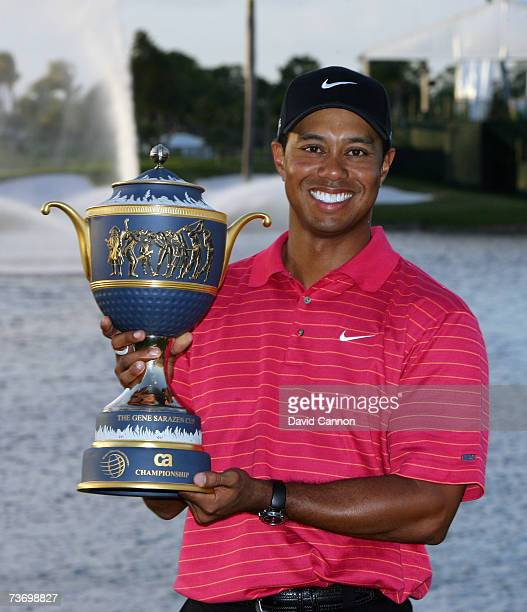 Tiger Woods of the USA holds the trophy after winning the 2007 World Golf Championships CA Championship held at the Doral Golf Resort and Spa March...