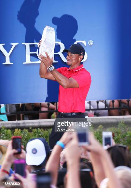 Tiger Woods of the USA holds the winner's trophy after the final round of THE PLAYERS Championship at THE PLAYERS Stadium course at TPC Sawgrass on...