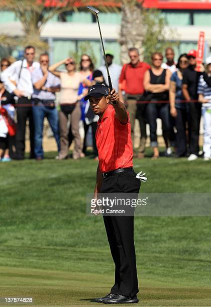 Tiger Woods of the USA holes a long putt for a birdie on the par 5, 2nd hole during the final round of the Abu Dhabi HSBC Championship at the Abu...