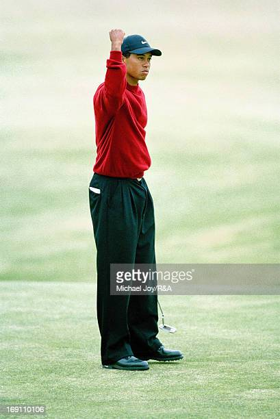 Tiger Woods of the USA holes the winning putt on the 18th green during the final round of the 2000 Open Championship held on the Old Course at St...