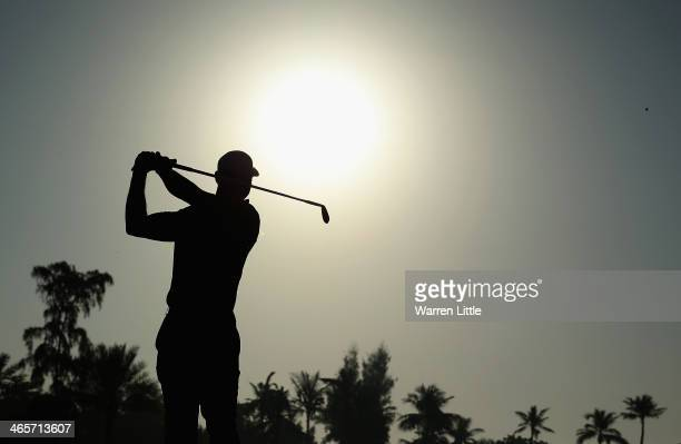 Tiger Woods of the USA in action during the proam as a preview for the 2014 Omega Dersert Classic on the Majlis Course at the Emirates Golf Club on...
