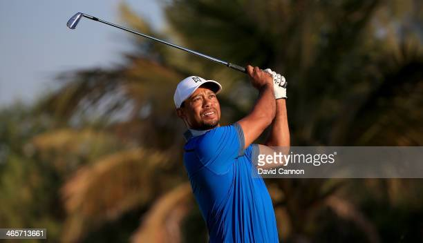 Tiger Woods of the USA in action during the proam as a preview for the 2014 Omega Dubai desert Classic on the Majlis Course at The Emirates Golf Club...