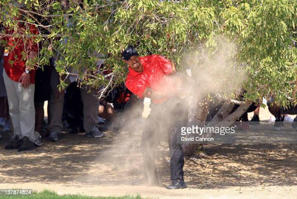 Tiger Woods of the USA in trouble for his third shot on the par 5, 2nd hole during the final round of the Abu Dhabi HSBC Championship at the Abu...