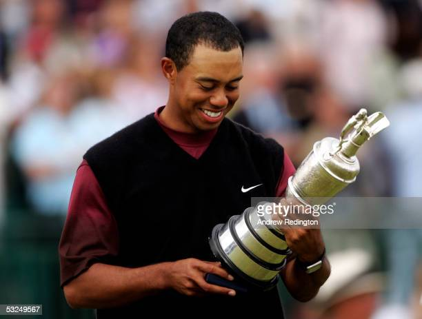 Tiger Woods of the USA inspects the Claret Jug after securing a five shot victory at the 134th Open Championship at Old Course St Andrews Golf Links...
