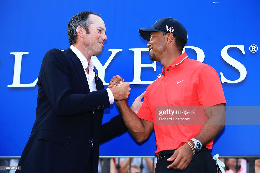 Tiger Woods of the USA is congratulated by Matt Kuchar after winning THE PLAYERS Championship at THE PLAYERS Stadium course at TPC Sawgrass on May 12, 2013 in Ponte Vedra Beach, Florida.