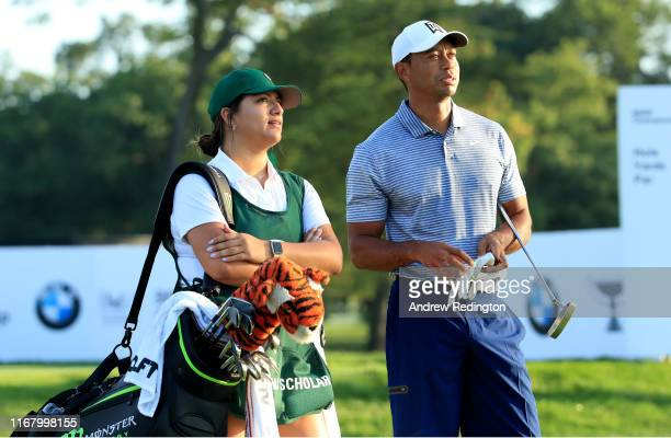 Tiger Woods of the USA is pictured with his Pro Am caddie Sarahi Ortiz, Evans Scholars Chapter President at the University of Oregon and Evans...