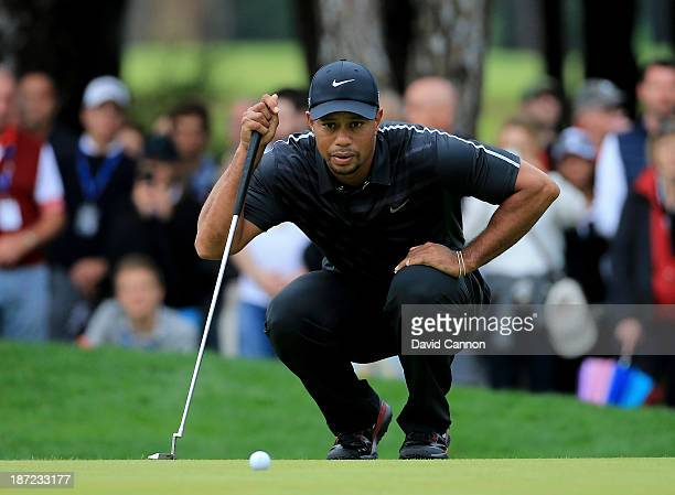 Tiger Woods of the USA lines up a putt at the par 3 second hole during the first round of the 2013 Turkish Airlines Open on the Montgomerie Maxx...
