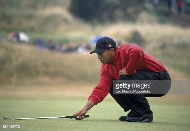 Tiger Woods of the USA lines up a putt during the British Open Golf Championship at Royal Birkdale Golf Club in Southport circa July 1998