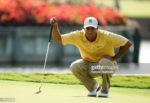 Tiger Woods of the USA lines up a putt on the 16th green during the second round of THE PLAYERS on The Stadium Course at the TPC Sawgrass on May 11...