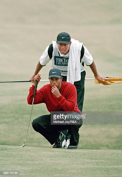Tiger Woods of the USA lines up his final putt at the 18th hole with his caddie Steve Williams of New Zealand during the final round of the 2000 Open...