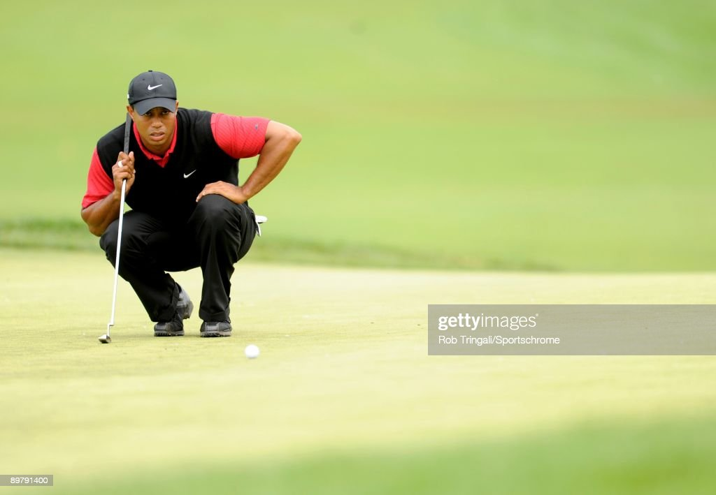 Tiger Woods of the USA lines up his putt on the 16th hole during the continuation of the final round of the 109th U.S. Open on the Black Course at Bethpage State Park on June 22, 2009 in Farmingdale, New York.