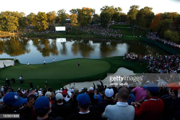 Tiger Woods of the USA makes birdie on the 17th hole during the Afternoon FourBall Matches for The 39th Ryder Cup at Medinah Country Club on...