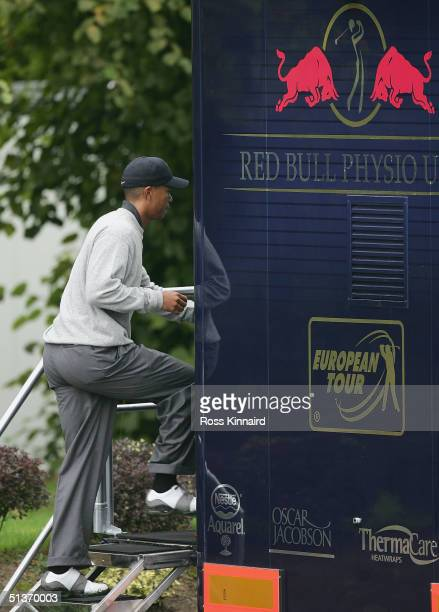Tiger Woods of the USA makes his way into the Red Bull Physio Unit after cutting short his practice round prior to the start of the American Express...
