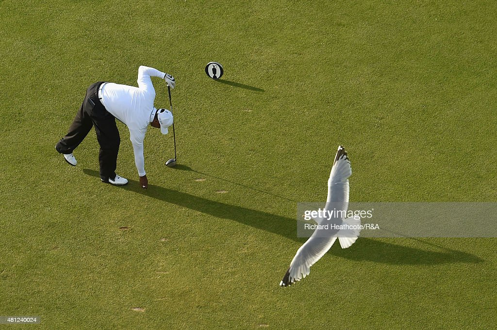 Tiger Woods of the USA pegs up his ball on the 18th tee as a seagul flies past during the second round of the 144th Open Championship at The Old Course on July 18, 2015 in St Andrews, Scotland.