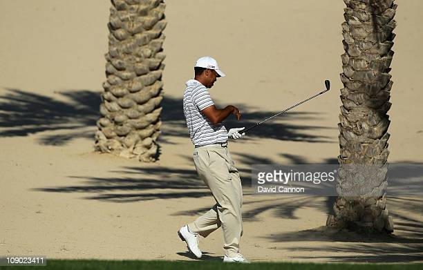Tiger Woods of the USA playing his second shot from the sand on the 14th hole during the third round of the 2011 Omega Dubai Desert Classic on the...