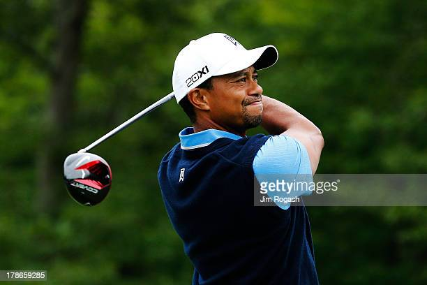 Tiger Woods of the USA plays a shot from the 14th tee during the first round of the Deutsche Bank Championship at TPC Boston on August 30, 2013 in...