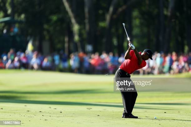 Tiger Woods of the USA plays a shot on the 15th hole during the final round of THE PLAYERS Championship at THE PLAYERS Stadium course at TPC Sawgrass...