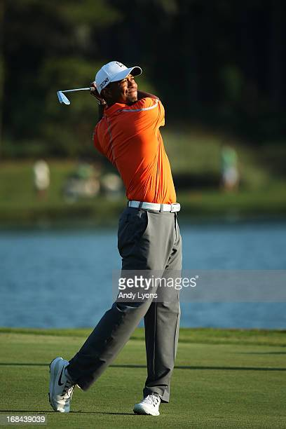 Tiger Woods of the USA plays a shot on the 18th hole during round one of THE PLAYERS Championship at THE PLAYERS Stadium course at TPC Sawgrass on...